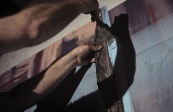 Andrew Fish, painting Tower. Film still: C49 Productions