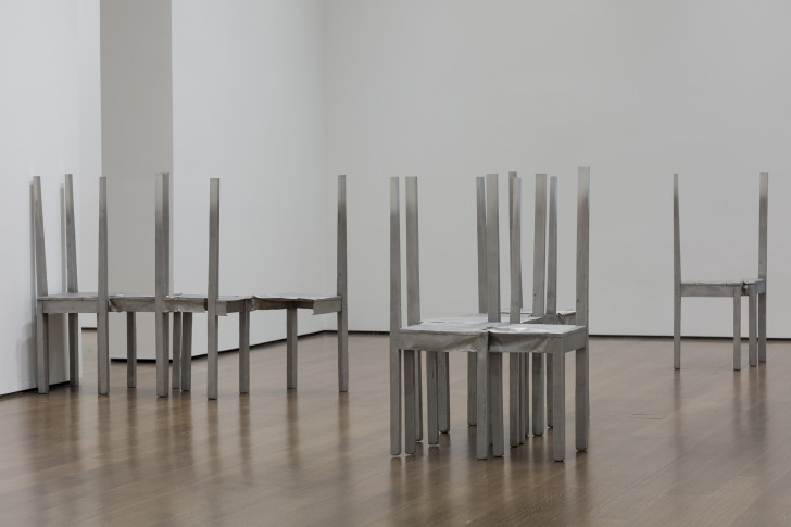 Installation view of Thou-less (detail) and untitled chair works in Doris Salcedo: The Materiality of Mourning, on display Nov. 4, 2016–Apr. 9, 2017 at the Harvard Art Museums. ©Doris Salcedo. Photo: Harvard Art Museums; ©President and Fellows of Harvard College